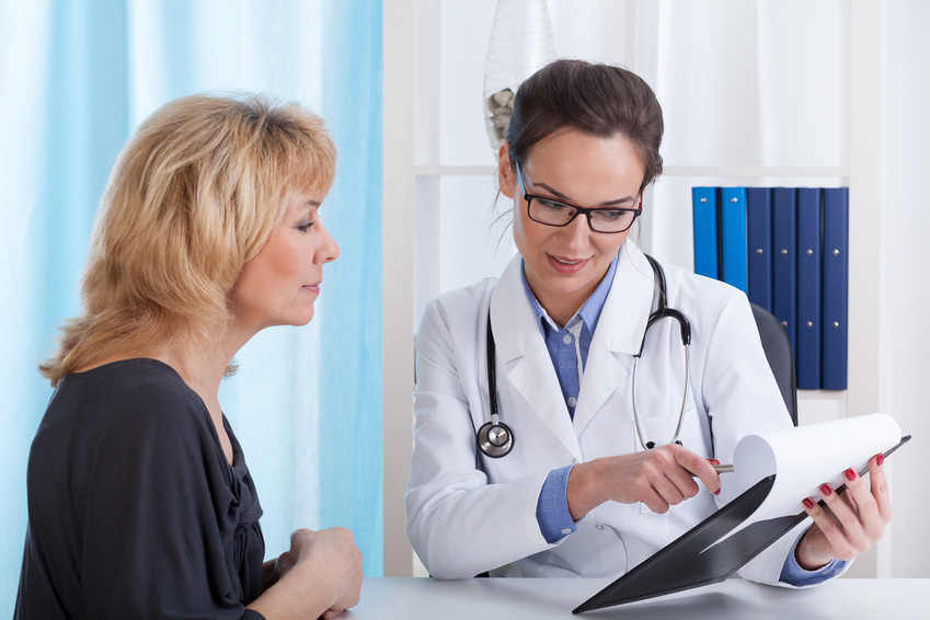 Doctor showing patient test results in office